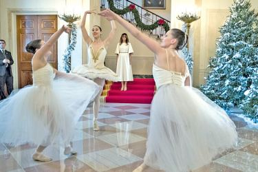What an entrance! First lady Melania walked down the Grand Staircase into the Grand Foyer to be greeted by a trio of ballerinas dancing to a piece from the Nutcracker as she kicked off her holiday tour