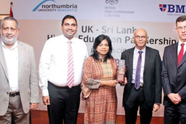 Pearson Regional Director Asia, Premila Paulraj presenting an award of excellence to President, BMS, Dr. W. A. Wijewardena.  Pearson Territory Manager Sri Lanka and the Maldives, Suriya Bibile Director Asia, British High Commissioner to Sri Lanka, James Dauris and President Chamber of Commerce Rajendra Thiyagarajah look on.