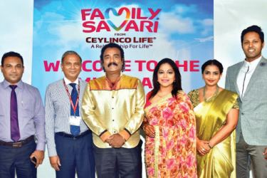 Ceylinco Life's Director and Deputy CEO Thushara Ranasinghe  with the four Family Savari ambassadors and a representative of the Western Province Revenue Department, at the mid-promotion draw.