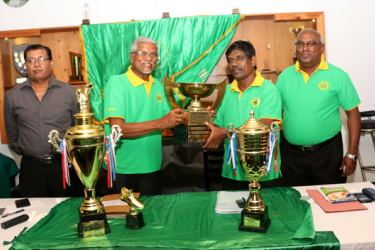 Thilak Peiris handing over the cup to P.G.P Peiris Vice President of Sri Lanka Soccer Masters Association (SLSMA). Also in the picture From left) Yoga Croos Secretary of Sri Lanka Soccer Masters Association and Desmond Joseph Chairman of the Tournament Committee.