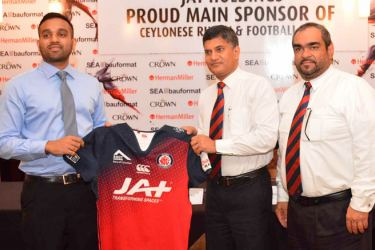 The new team jersey of the club is being handed over to President of CR and FC Sriyan Cooray (centre) by Director of JAT Holdings Richard Gunawardena at a media briefing held at the Club pavilion at Longden Place. General Secretary of CR and FC Hamza Hassanally is also in the picture. Picture by Sarath Peiris
