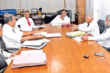 Labour and Trade Union Relations Minister W.D.J. Seneviratne during the discussion with officials.