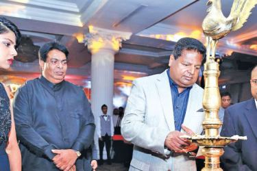 Nalin Welgama, Chairman Ideal Group lighting the oil lamp to inaugurate Club Mahindra in Sri Lanka.