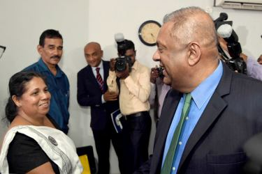 Finance and Media Minister Mangala Samaraweera met Sandya Ekneligoda, wife of disappeared journalist Prageeth Ekneligoda at the official launch of the Sri Lanka Working Journalists Association (SLWJA)  website at the Sri Lanka Press Institute yesterday. SLWJA President Lasantha Ruhunage and General Secretary Duminda Sampath were also present. Picture by Rukmal Gamage