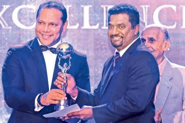 Cricket legend Muttiah Muralitharan receiving the award for Sports Excellence and Contribution from the Sports Minister