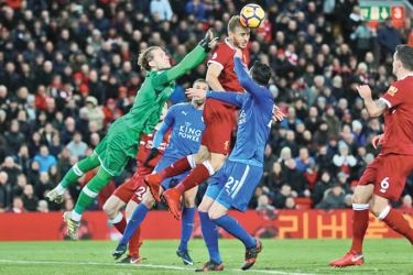 Liverpool's Ragnar Klavan in action with Loris Karius and Leicester City's Vicente Iborra Action