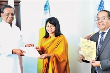 Minister of Tourism Development and Christian Religious  Affairs, John Amaratunga presenting letters of appointment to General Manager Inoshini Perera and new  Chairman, SLCB, Kumar De Silva.