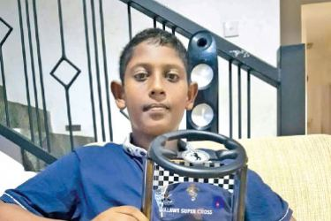 Kesara Godage with the Youngest Car Driver award which he won at Walawa Supercross.