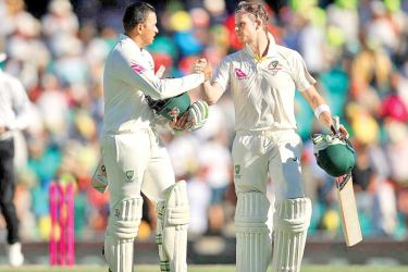 Usman Khawaja and Steve Smith helped Australia take a grip of the Fifth Test in Sydney on January 5. AFP