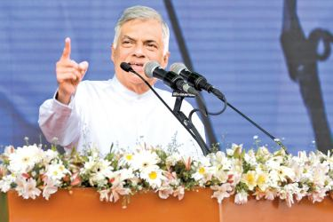 Prime Minister Ranil Wickremesinghe addressing the gathering. Pictures by Rukmal Gamage