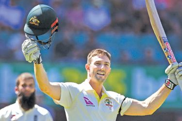 Australia's Shaun Marsh celebrates scoring his century against England on the fourth day of the fifth Ashes cricket Test match at the SCG in Sydney on January 7, - AFP