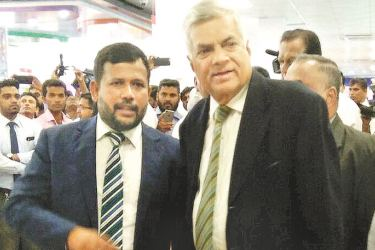 Minister of Industry and Commerce Rishad Bathiudeen and Prime Minister Ranil Wickremesinghe having unveiled the first Lanka Sathosa Mega Model Outlet at Welisara on  January 5.