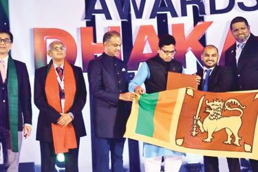 Viranga Kekulawala,  CEO of Eimsky Business Solutions and Samitha Nagasinghe,  General Manager of Omobio receiving the merit award. Also present are Bangladeshi State Minister Zunaid Ahmed Palak, Hong Kong Government Chief Information Officer Allen Yeung, APICTA Chairman Dr Dileepa De Silva and Convenor Russell T Ahmed.