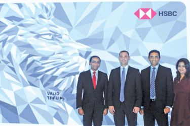 HSBC Country Head for Retail Banking and Wealth Management, Nadeesha Senaratne with officials at the launch of the cashback credit card. Picture by Saliya Rupasinghe