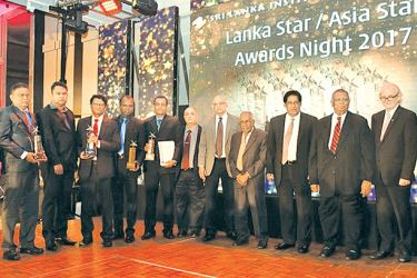 Officials from JF Packaging (Pvt) Ltd with the awards
