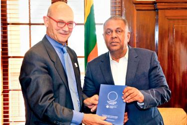 French Inter-ministerial Delegate Pascal Lemy presenting Minister Mangala Samaraweera with France's environmentally sustainable proposal for World Expo 2025.