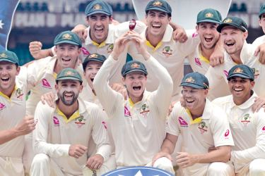 Australia's cricket team celebrates after retaining the Ashes trophy, defeating England on the final day of the fifth Ashes cricket Test match at the SCG in Sydney on January 8, AFP