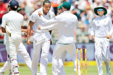 South Africa's fastest bowler Kagiso Rabada celebrates an Indian wicket at Newlands.