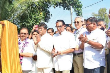 Minister of Higher Education and Highways Lakshman Kiriella with other officials at the event.