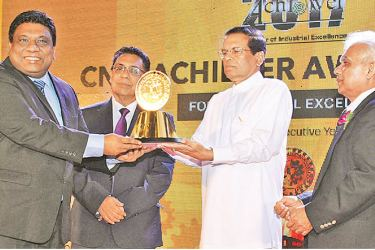 PBSS Managing Director Madura Gamanayake receiving the gold award from President Maithripala Sirisena for the  SME Category Service sector at the CNCI Achiever Awards held recently in Colombo