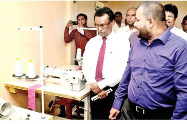 Minister of Industry and Commerce Rishad Bathiudeen visits a mini apparel factory supported by his Ministry in the Northern Province.