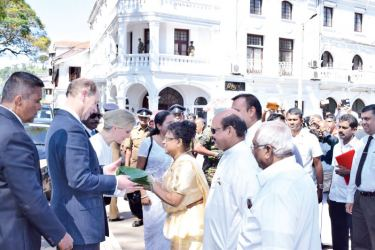 The Earl of Wessex, Prince Edward and Countess Sophie who visited Kandy yesterday were welcomed to the city by Central Province Governor Niluka Ekanayake and Central Province Chief Minister Sarath Ekanayake who presented them with a sheaf of betel - the traditional method of greeting, near the Queen's Hotel in Kandy. Picture by Asela Kuruluwansha