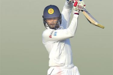 Dhananjaya de Silva  plays a shot during the second day of the first cricket Test between Bangladesh and Sri Lanka at Zahur Ahmed Chowdhury Stadium in Chittagong on February 1. AFP