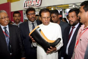 The 10th edition of the Footwear and Leather exhibition organized by the Sri Lanka Footwear and Leather Products Manufacturing Association  was inaugurated by President Maithripala Sirisena at the BMICH yesterday. Here, the President at a stall. Minister Rishad Bathiudeen and State Minister Sujeewa Senasinghe  are also present.  Picture by Sulochana Gamage.