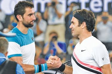 Switzerland's Roger Federer shakes hands with Croatia's Marin Cilic after Federer won the final