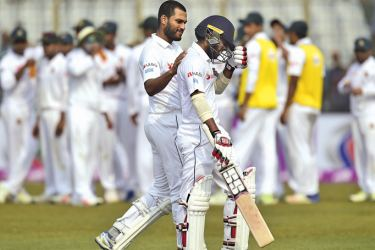 Roshen Silva consoles his Sri Lankan team mate Kusal Mendis after the latter was dismissed for 196 on the third day of the first cricket Test against Bangladesh at the Zahur Ahmed Chowdhury Stadium in Chittagong on Friday. AFP