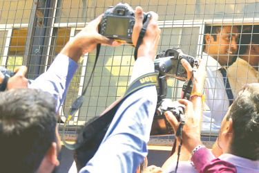 Perpetual Treasuries Limited beneficiary owner Arjun Aloysius and its Chief Executive Officer Kasun Palisena arriving at the Colombo Fort Magistrate's Court yesterday. Picture by Rukmal Gamage