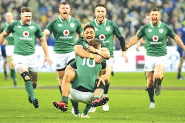 Ireland's Jonathan Sexton (R) celebrates with Bundee Aki after scoring a drop goal to win the Six Nations match against France
