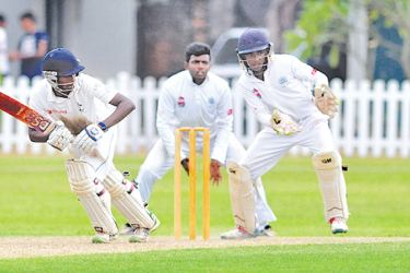 Maneesha Rupasinghe of S Thomas' College Mt Lavinia strokes the ball to leg during his innings of 133 on the first day of their school cricket match against St Benedict's College played at Mt Lavinia yesterday. Picture by Susantha Wijegunasekara