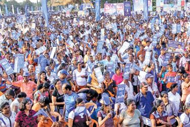 President Maithripala Sirisena addressing the large crowd at the meeting at Polonnaruwa yesterday.  Pictures courtesy President's Media Division