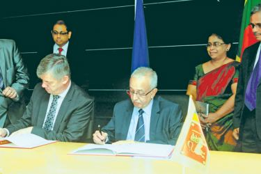 Ambassador Extraordinary and Plenipotentiary of the Czech Republic in India, accredited to Sri Lanka Milan Hovorka and Minister Malik Samarawickrama signing the agreement. Picture by Wasitha Patabendige.