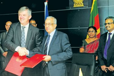 Ambassador Extraordinary and Plenipotentiary of the Czech Republic in India, accredited to Sri Lanka, Milan Hovorka exchanging the agreement on behalf of the Minister of Industry and Trade of Czech Republic with Development Strategies and International Trade Minister Malik Samarawickrama. Picture by Vasitha Patabendige
