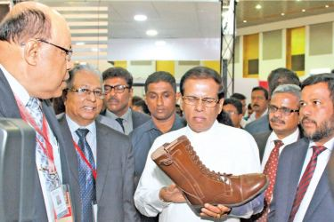 President Maithripala Sirisena participated as the chief guest at the inauguration of the Footwear and Leather Fair 2018 which ended at BMICH last week. Here the President visiting the Irosha International (Pvt) Ltd stall which manufactures safety shoes, canvas shoes and leather boots for the Sri Lankan military forces for the past decade. Manager Import and Export, Vicum Liyanaarachchi, General Manager, Gerard J. Jennycloss, Chairman Footwear and Leather Association, Ranjith Hettarchchi, Minister of Indust