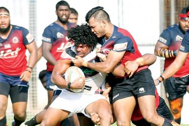 Third row forward Sudarshan Muthuthantri making his first appearance for CH&FC is well tackled by CR&FC's Rehan Silva in the Dialog 'A' division league rugby second round match played at Longden Place. CH won 25-24. (Picture Samantha Weerasiri)