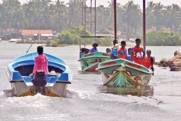 People living in islets in the Kalpitiya Peninsula arrive by boat at the Mohoththuwarama village polling centre to cast their votes, on Saturday. Picture by Prasad Poornamal Jayamanna, Puttalam Group Corr.
