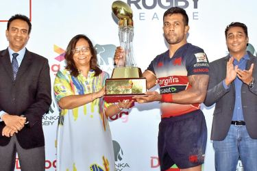 Kandy SC skipper, Gayan Weeraratne receiving the Dialog Rugby League champions trophy from Amali Nanayakkara, Group Chief Marketing Officer, Dialog Axiata PLC. Priyantha Ekanayake – Chief Executive Officer, Sri Lanka Rugby & Harsha Samaranayake – General Manager, Brand & Media, Dialog Axiata PLC are also present.
