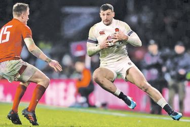 England's Jonny May in action with Wales' Gareth Anscombe