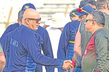 Sri Lanka head coach Chandika Hathurusingha shakes hands with his Bangladesh counterpart Khaled Mahmud at the end of the series.