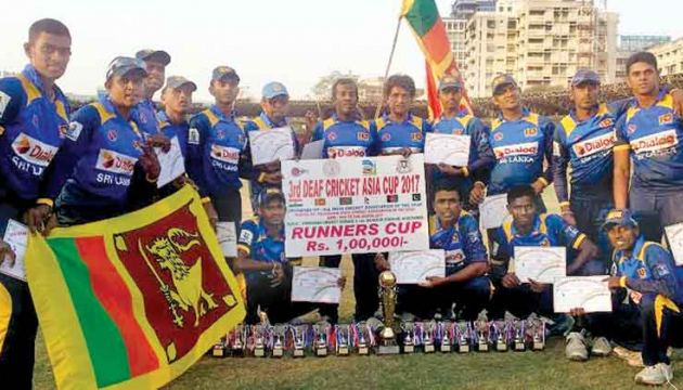 Asia Deaf cricket runner-up Sri Lankan team with their trophies
