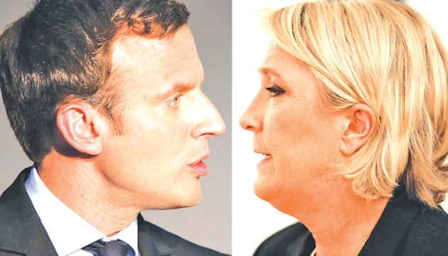 Emmanuel Macron (L) set to go head-to-head with Marine Le Pen.