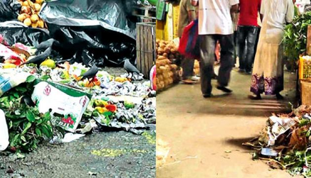 Mounds of uncollected garbage piled up at the Kandy Central Market premises. Picture by Asela Kuruluwansa