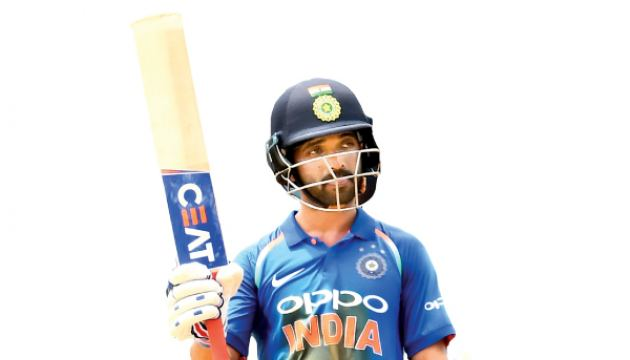 India's Ajinkya Rahane celebrates after scoring his century during the second One Day International (ODI) match between West Indies and India at the Queen's Park Oval in Port of Spain, Trinidad, on June 25. AFP