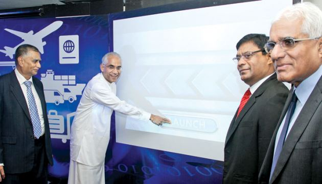 Minister Eran Wickramaratne and other officials launching the LankaPay Online Payment Platform. Picture by Ruwan Silva