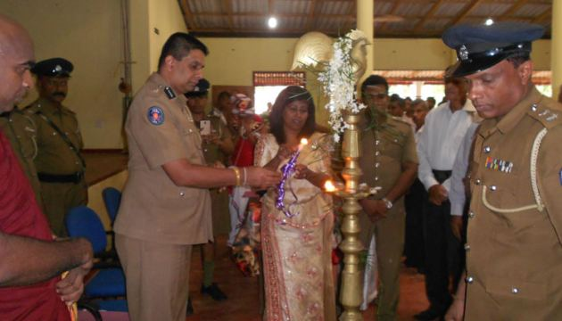 Matara Division Superintendent of Police T.H. Marapana lightning the oil lamp at the opening ceremony. Picture by P.P.G. Sugathadasa