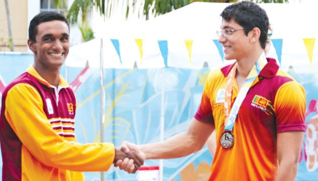 Sri Lanka's Akalanka Peiris who finished fifth in the 50 metres backstroke event (on left) and Kyle Abeysinghe who won the Silver medal in the 100 metres freestyle event. Picture by Prince Gunasekera