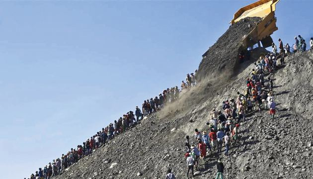 Myanmar miners search for jade stones at a mine dump in Hpakant, Kachin state.